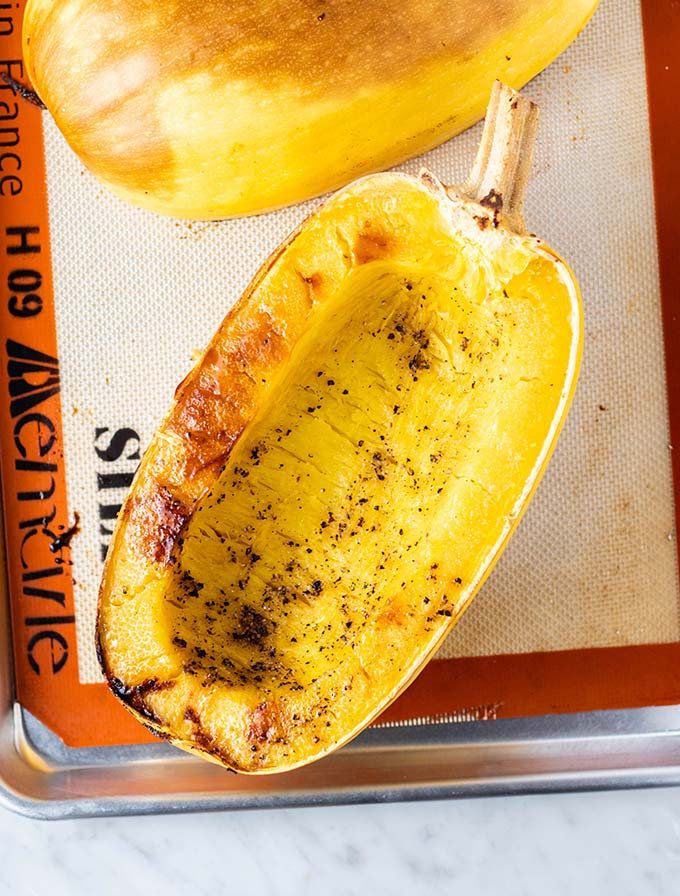 A baking tray with a roasted spaghetti squash.