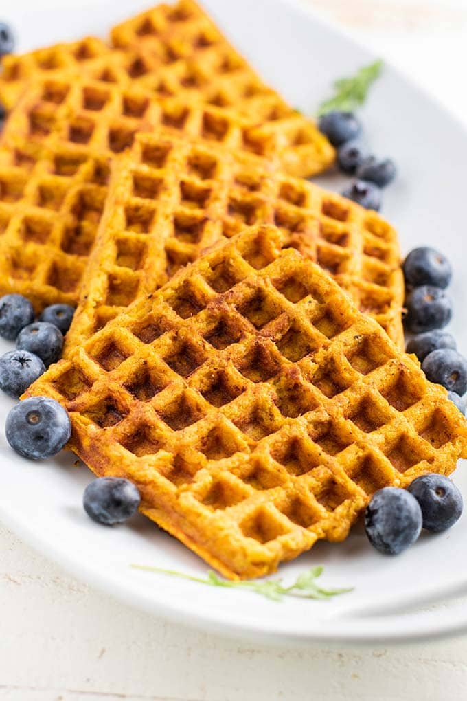 A plate showing a front view of a plate of sweet potato waffles.