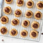 Rows of SunButter blossom cookies on a cooling rack.