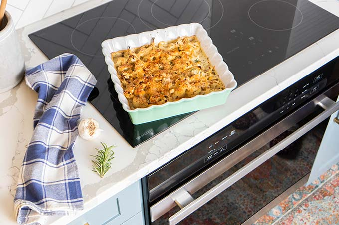 A baked dish of cauliflower cheese sitting on top of the Sharp European Convection Oven.