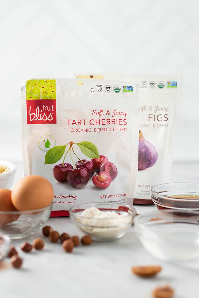 Two bags of Fruit Bliss Dried Cherries and Dried Figs.