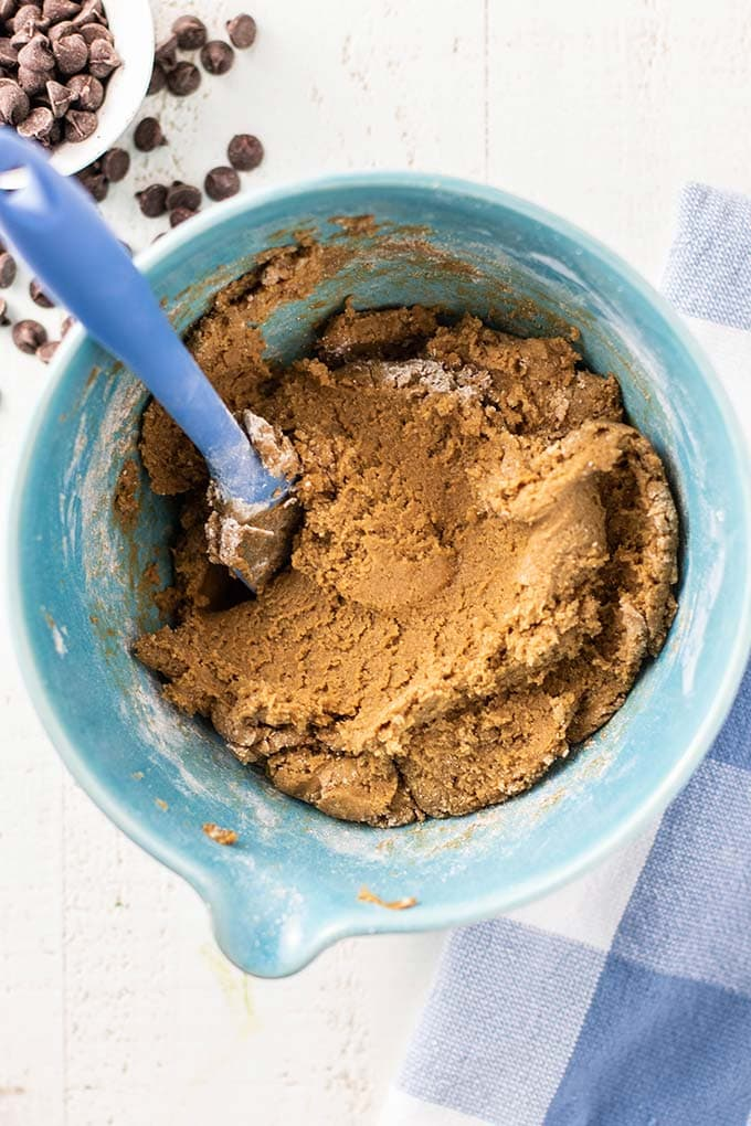 SunButter cookie dough in a blue bowl ready to be scooped.