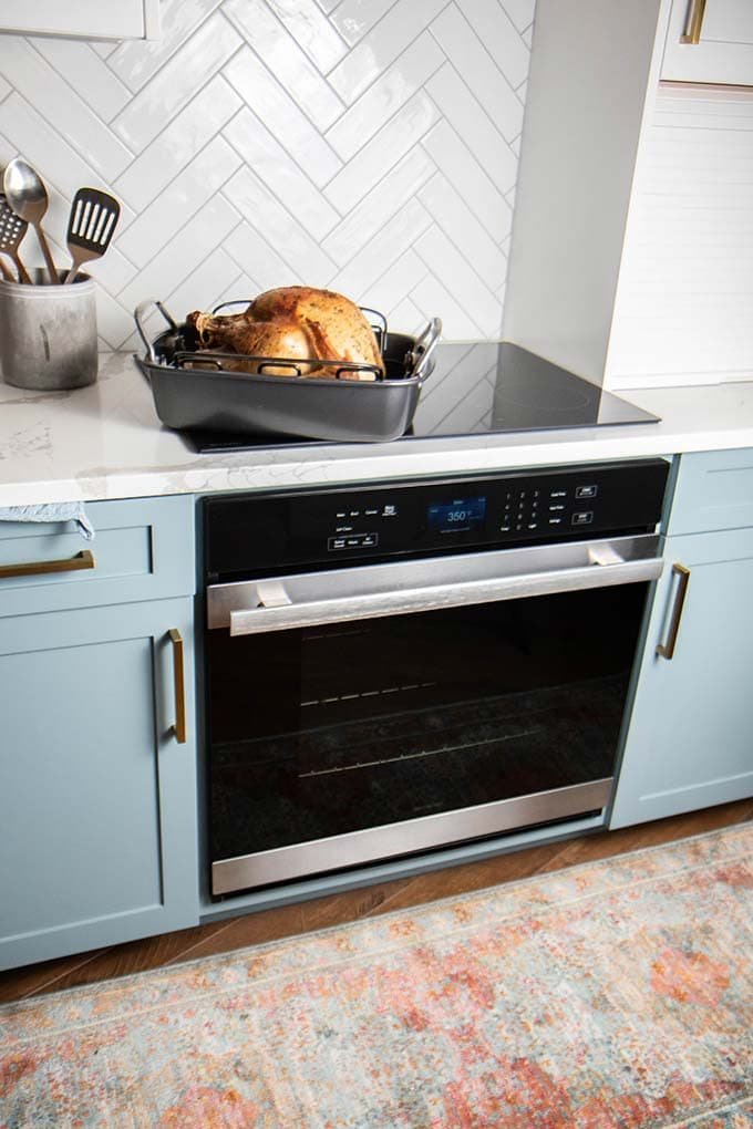 A turkey in a roasting pan sitting on top of the Sharp European Convection Oven.