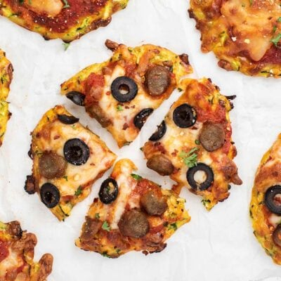A close up of a mini zucchini pizza cut into 4 slices.