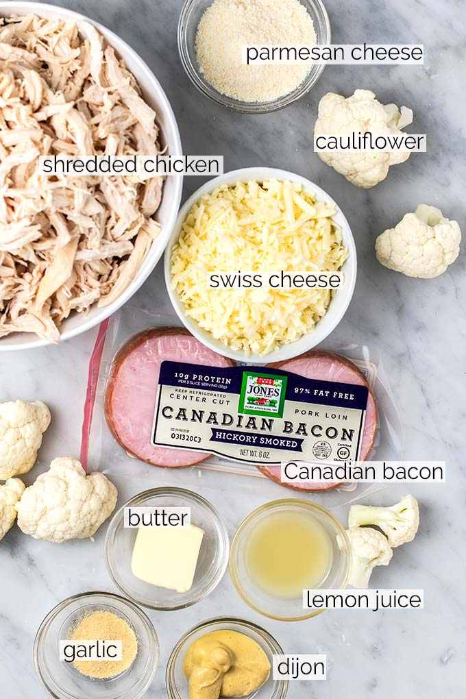 The ingredients for a chicken cordon bleu casserole with a caulifower cheese sauce.