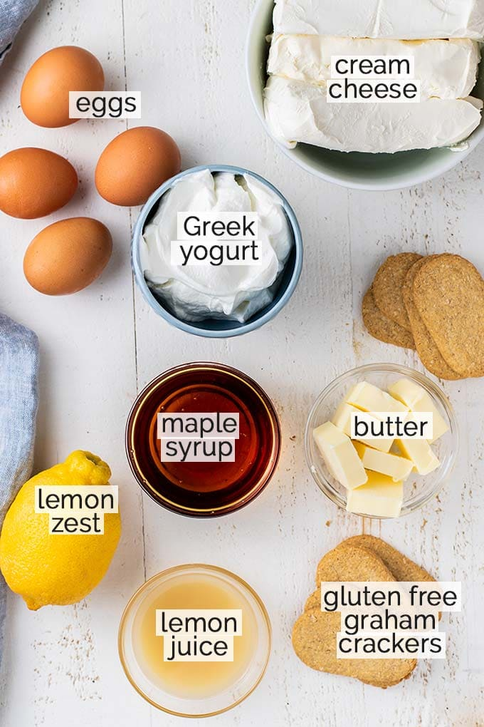 An image showing all the ingredients for this cheesecake recipe labeled.