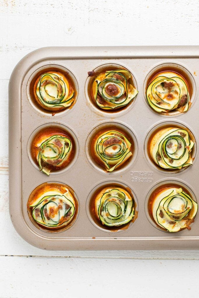A look at zucchini lasagna rolls baked in a muffin tin.