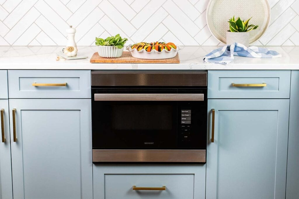 The Sharp Superheated Steam Wall Oven shown with a finished vegetable dish.