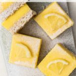 A close up look at lemon bars cut into squares.