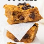 A stack of 3 pumpkin chocolate chip cookie bars.
