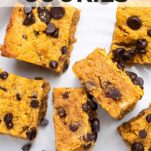 Keto Pumpkin Cookies with lots of chocolate chips, sliced into squares and served on a white plate.