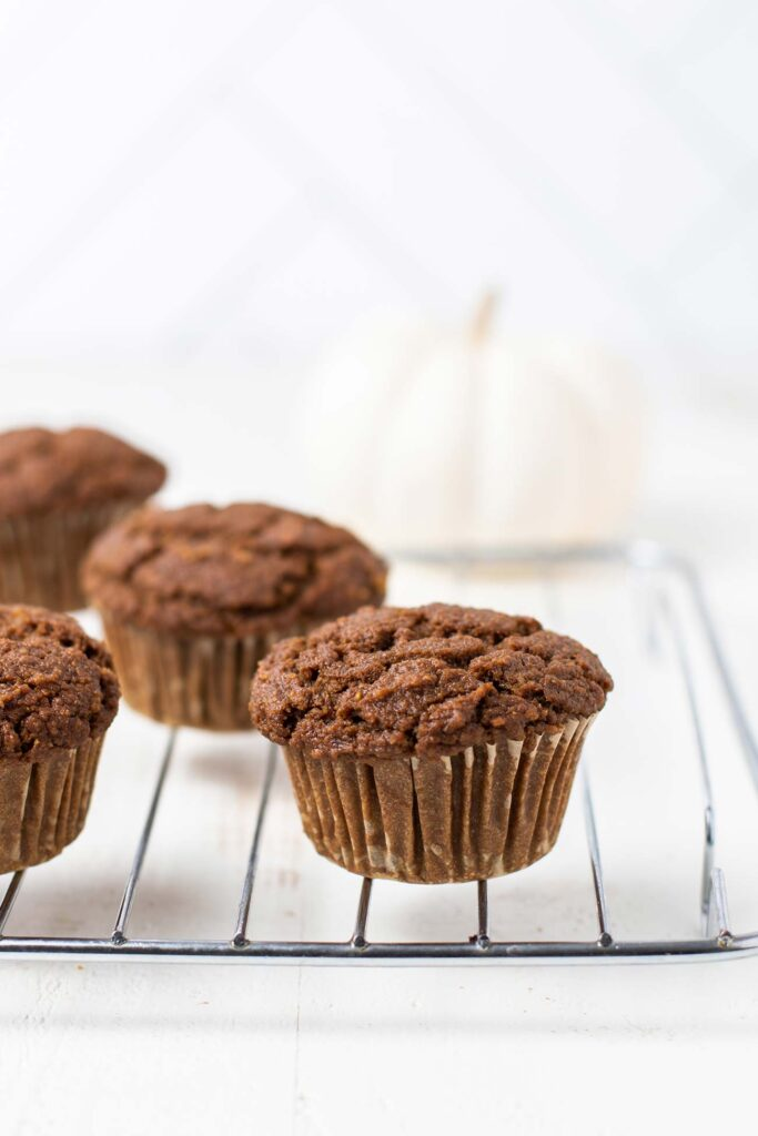 Pumpkin Gingerbread Muffins on a cooling rack.