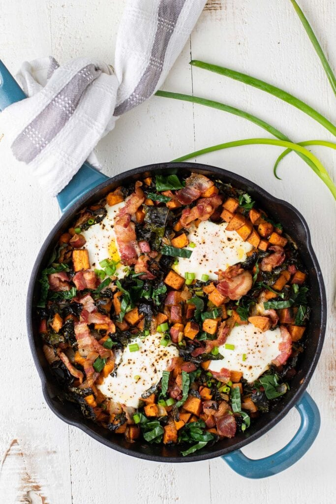 A sweet potato breakfast skillet baked with 4 eggs on top.