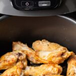 Wings shown in an air fryer.