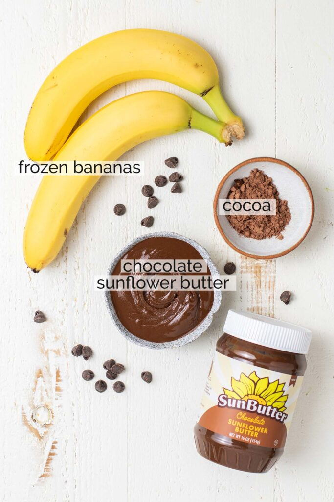 Bananas, cocoa powder, and chocolate sunbutter shown ready to make a smoothie bowl.