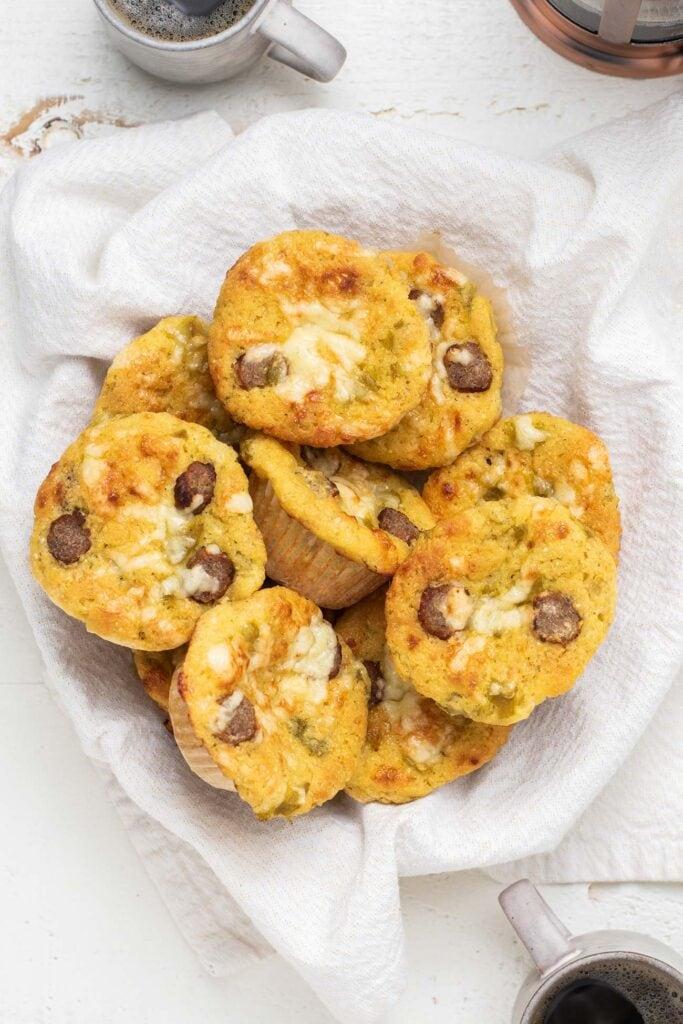 Cornbread muffins arranged in a basket.