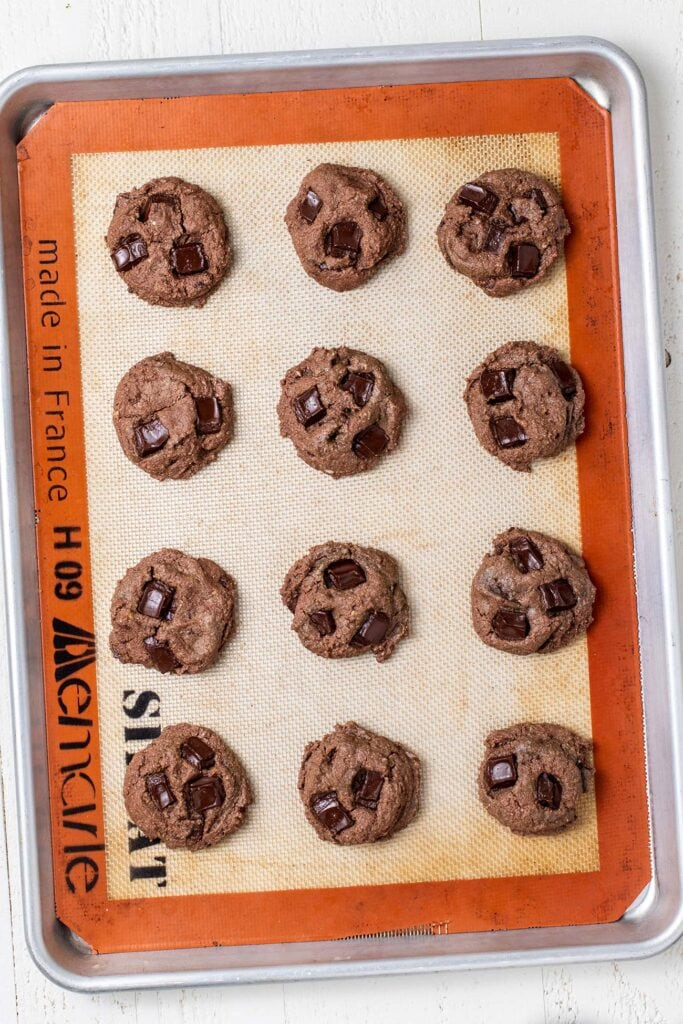 Double chocolate chip cookies shown baked on a tray.