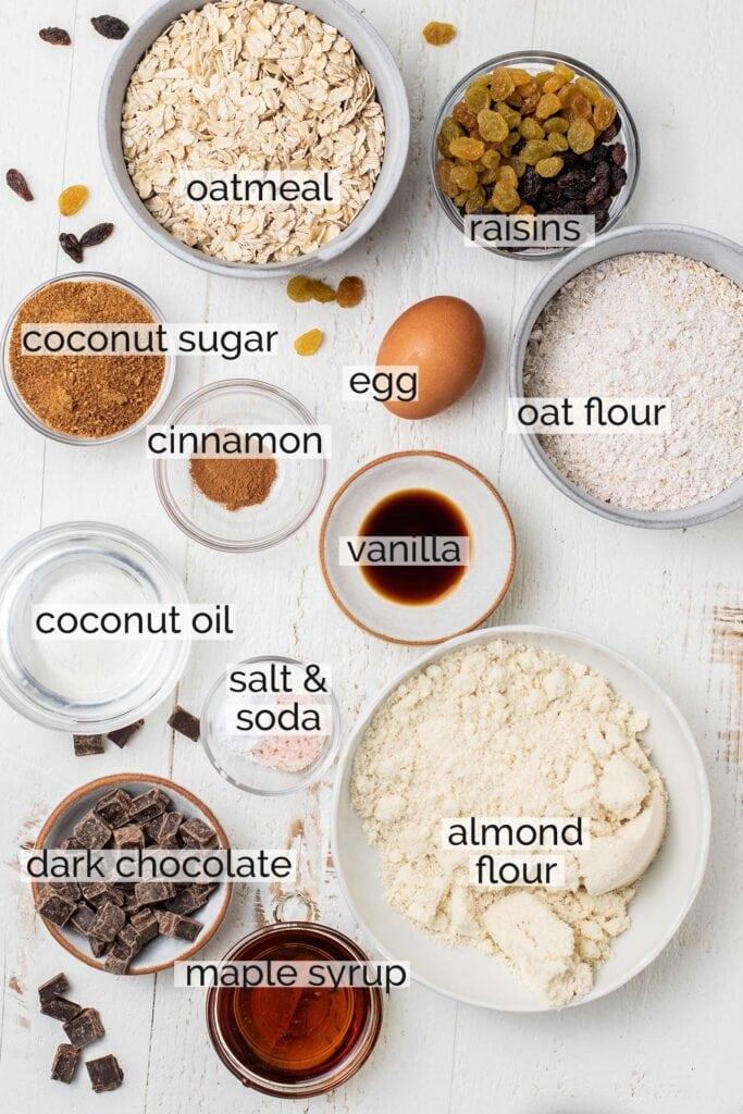The ingredients needed to prepare oatmeal raisin cookies.