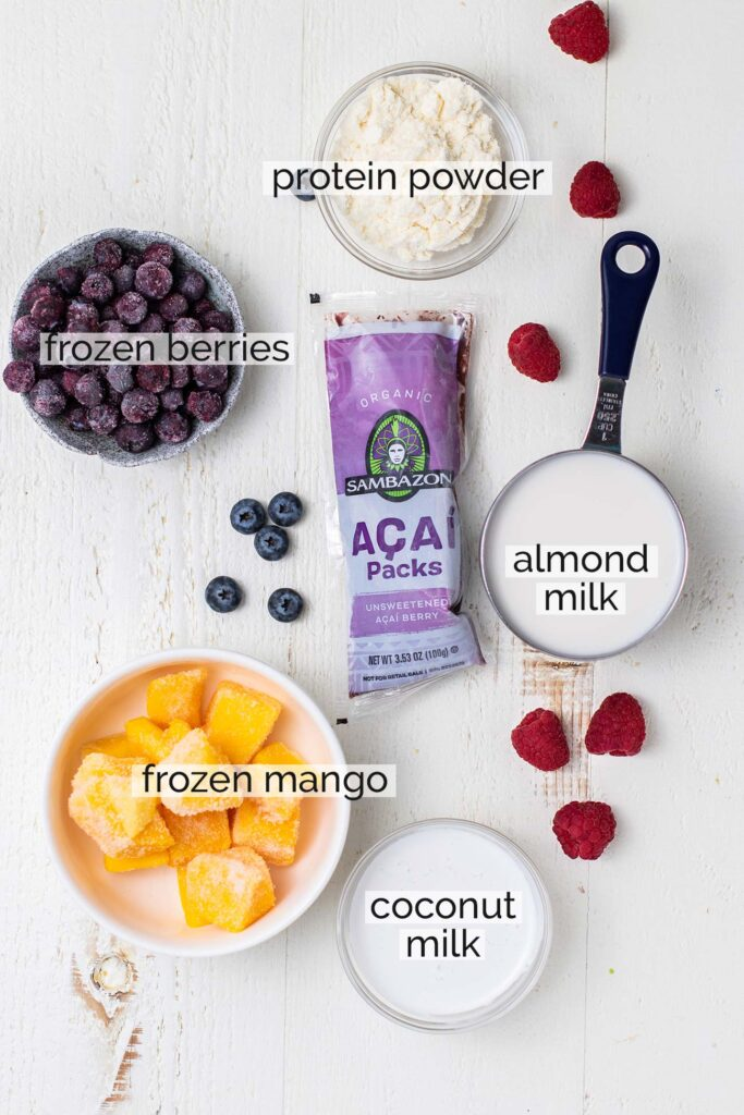All the ingredients needed to prepare an acai smoothie shown labeled.
