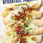A close up look at crispy air fried taquitos topped with avocado crema and salsa.