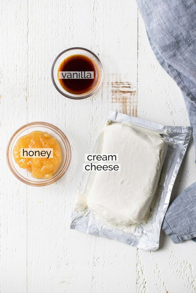 The ingredients needed to make a lightly sweetened cream cheese frosting.