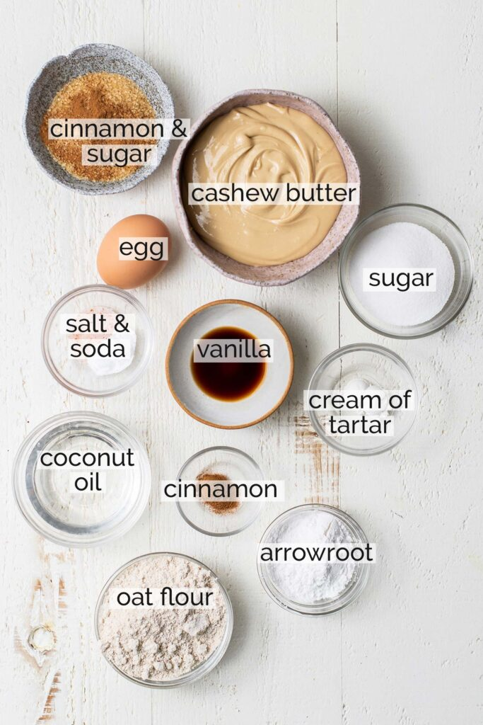 The ingredients needed to make snickerdoodles shown with labels.