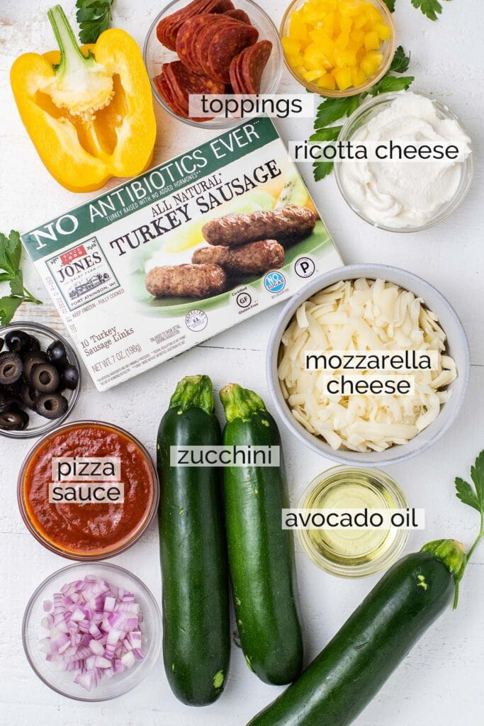 The ingredients needed to prepare grilled zucchini pizza boats