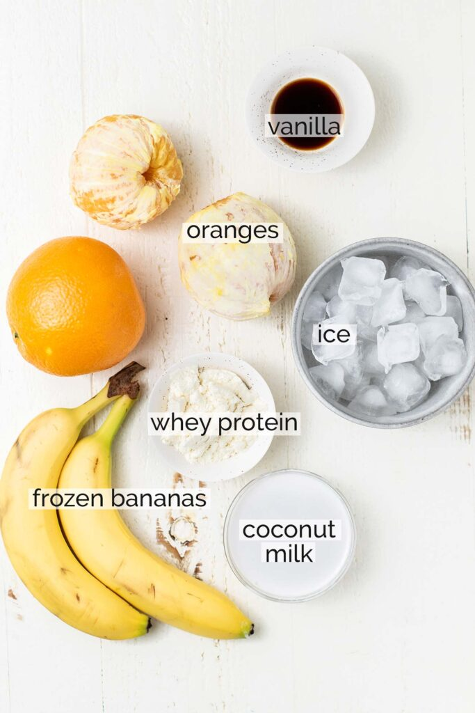 The ingredients for an Orange Julius Smoothie shown labeled.