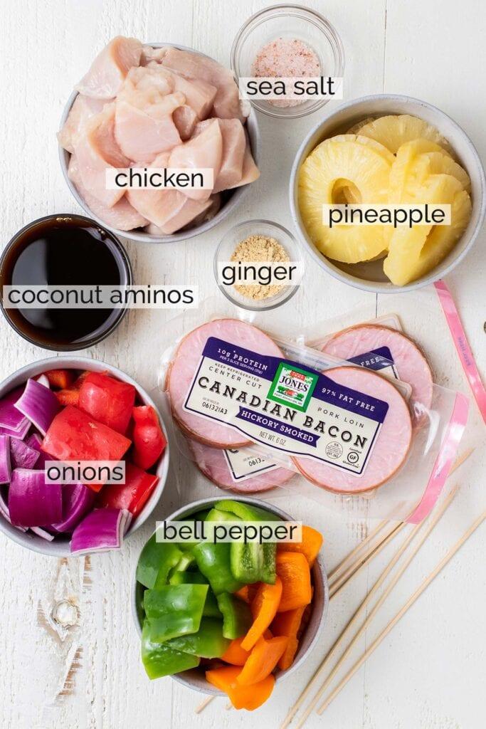 The ingredients needed to make teriyaki chicken skewers.