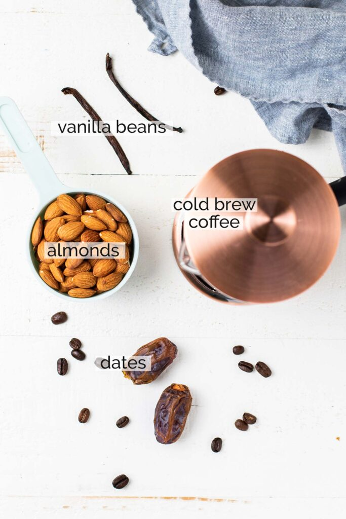 The ingredients needed to make an iced almond milk latte.