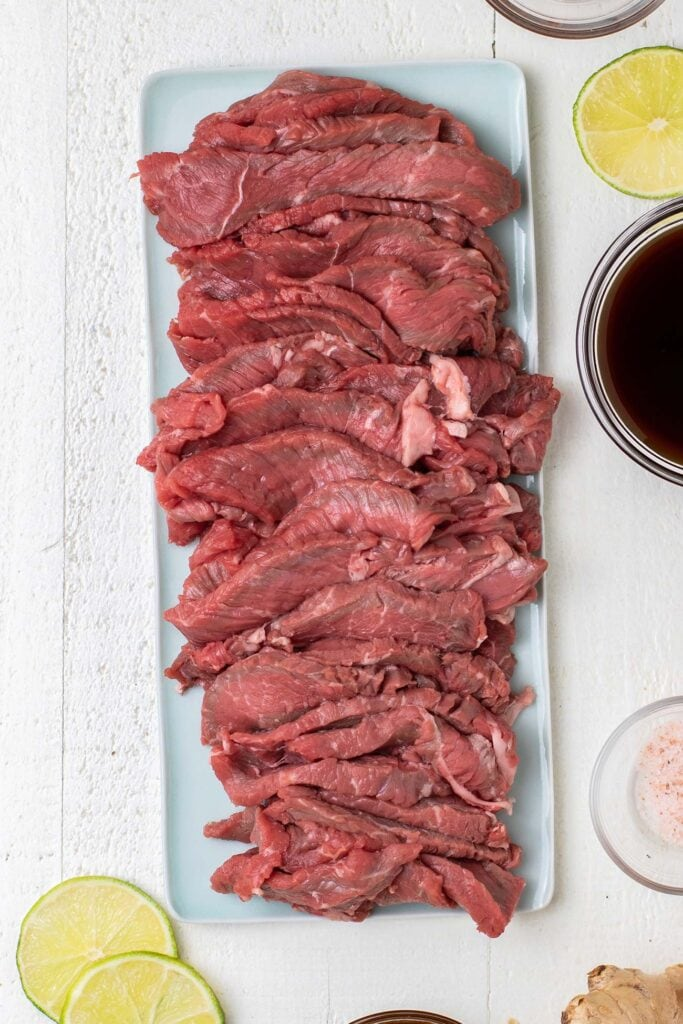 Thinly sliced beef showing how to cut the steak.