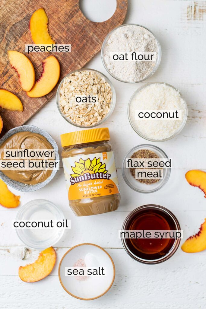 The ingredients needed to make a peach crisp shown with labels.