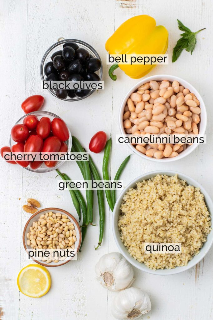 The ingredients needed for this salad, along with labels to show how to prepare them.
