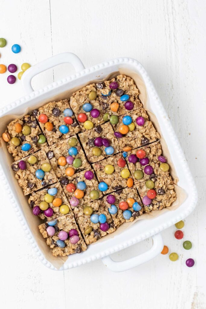 A white baking dish with cookies cut into squares in it.